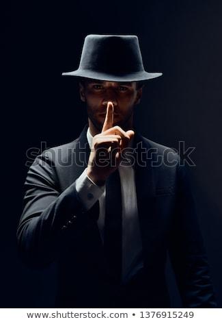 Tajne młodych przystojny mężczyzna odizolowany człowiek oglądać Zdjęcia stock © sapegina