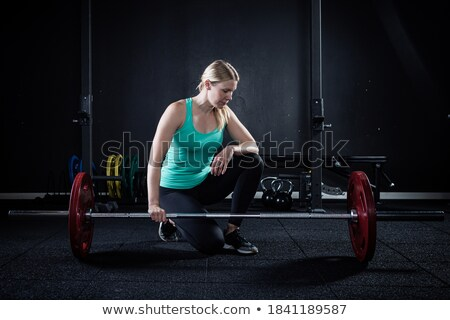 Pretty girl with red barbells stock photo © Nobilior