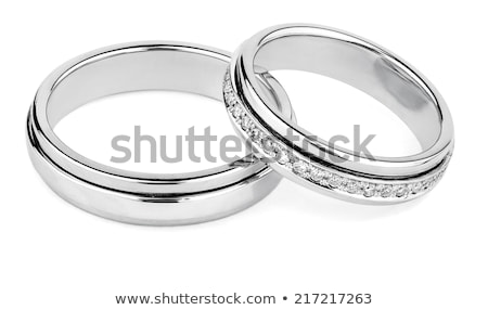 isolated couples of platinum diamond wedding rings stock photo © vichie81
