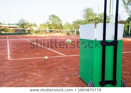 Sporting equipment: throwing a tennis ball. Stock photo © Dizski