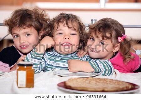 Three sisters enjoying crepes. Stock photo © photography33