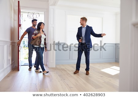 Realtor showing a couple a property Stock photo © photography33