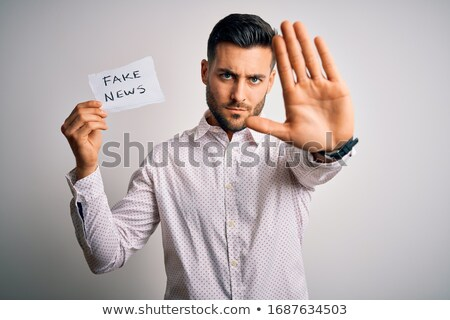 Expressive hommes blanche signe un message Photo stock © photography33