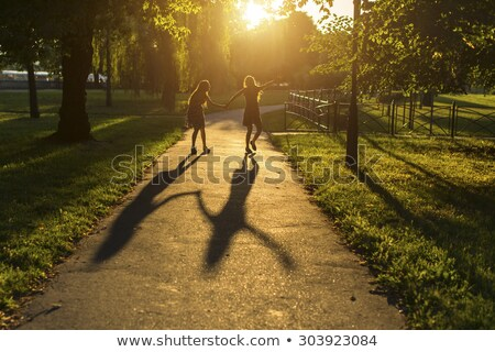 two girls in the park stock photo © massonforstock