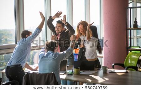 Travail équipe célébrer femme affaires groupe Photo stock © ambro