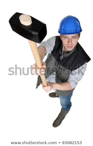 Construction worker holding a loft a sledgehammer Stock photo © photography33