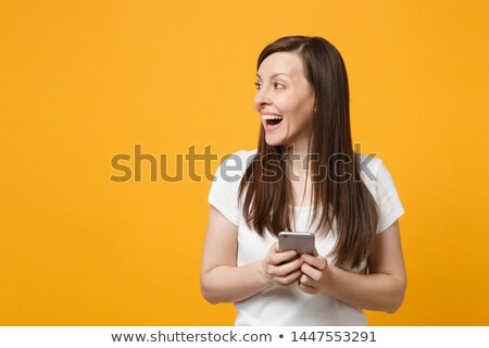 Portrait of laughing girl with oranges  Stock photo © OleksandrO