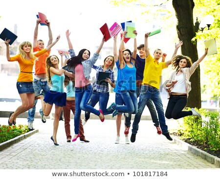 Cute students together in the nature with books Stock photo © azmo31