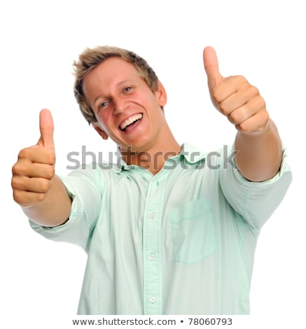 young man holding thumbs up stock photo © feedough