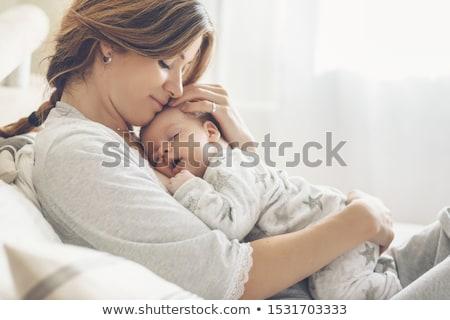 Madre baby laptop giocattoli camera da letto seduta Foto d'archivio © photography33