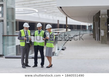 foreman in reflective work wear examining plans stock photo © photography33