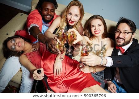 Ubriaco divano flauto champagne donna Foto d'archivio © photography33