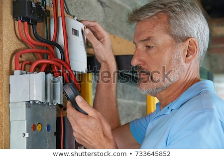 Electrician taking electrical reading Stock photo © photography33