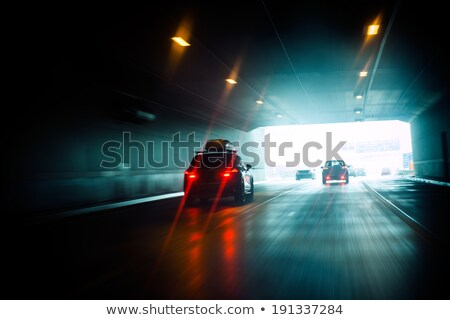 Car exiting a dark tunnel Stock photo © ifeelstock