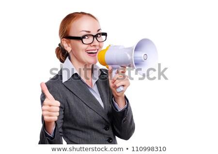 Saleswoman with megaphone against a white background stock photo © wavebreak_media