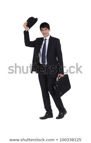 Businessman tipping his bowler hat Stock photo © photography33
