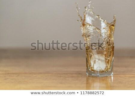 Ein Whiskey Glas Felsen Eis trinken Stock foto © alex_l