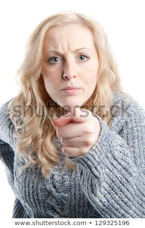 Wściekły młoda kobieta ktoś palec niebieski shirt Zdjęcia stock © pablocalvog