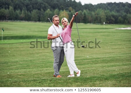 Zdjęcia stock: Side View Of Woman Holding Golf Stick