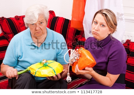young blonde woman gets uninspired presents Stock photo © Pasiphae