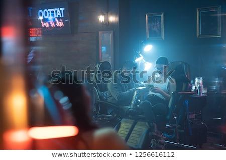 Woman getting tattooed. Stock photo © iofoto