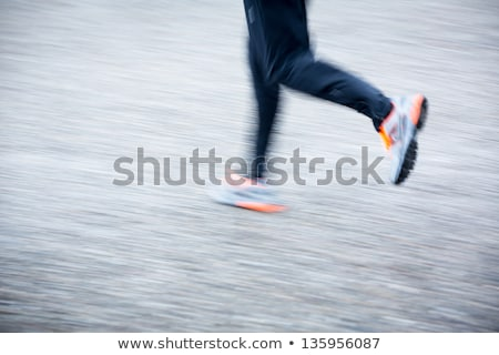 motion blurred runners feet in a city environment stock photo © lightpoet