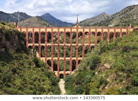 aqueduct named el puente del aguila in nerja andalusia spain stock photo © nobilior