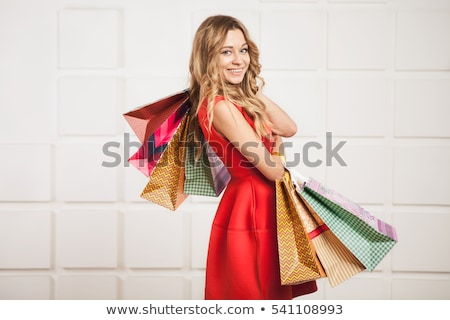 Foto d'archivio: Shopaholic Woman With Colorful Bags Over White