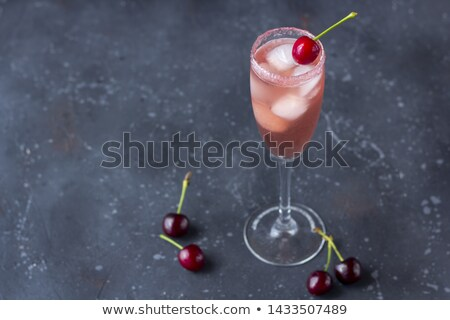 cherry in champagne stock photo © taden