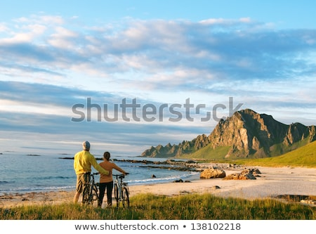 Stock photo: cyclists relax biking outdoors
