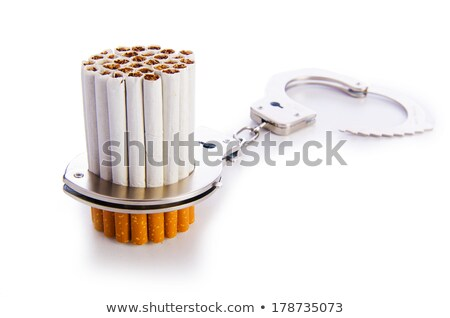 addition concept with cigarettes and handcuffs stock photo © elnur