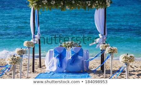 Decorated wedding table on the beach, soft evening light Stock photo © moses