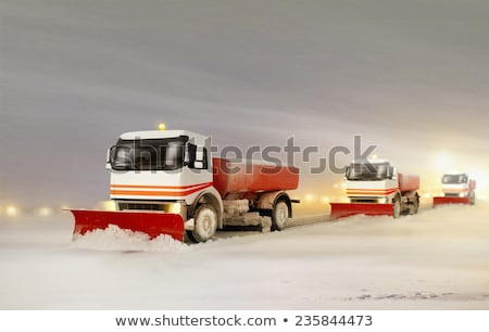 Stok fotoğraf: Snowplow Removing The Snow From The Highway During A Snowstorm
