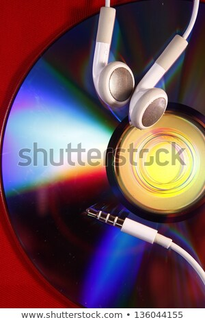cd and ear piece or ear buds Stock photo © junpinzon