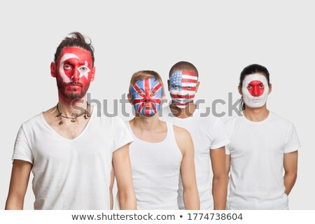 happy football fans cheering against various national flags stock photo © deandrobot