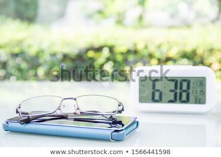 Szemüveg ébresztőóra kávé lövés fehér asztal Stock fotó © nito