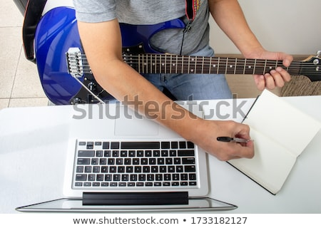Male hands playing on classical guitar Stock photo © Valeriy