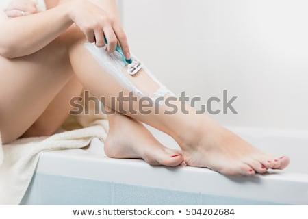 Woman Shaving On Bathtub Stock photo © Kakigori