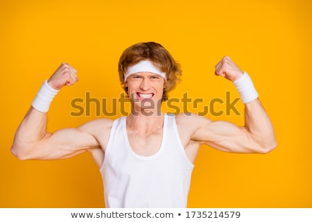 close up of young man showing biceps Stock photo © dolgachov
