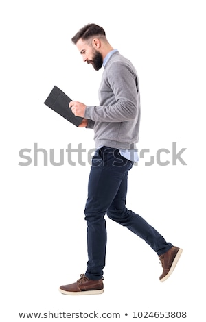 Full body of a young business man walking Stock photo © feedough