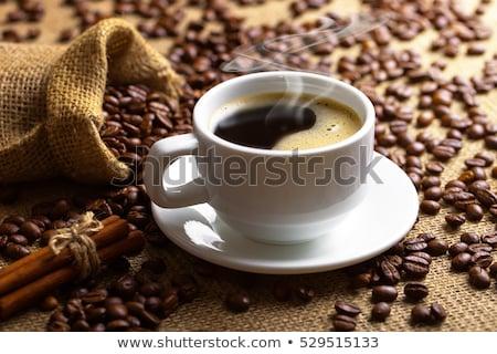 Copo café preto colher pires tabela bebidas Foto stock © dolgachov