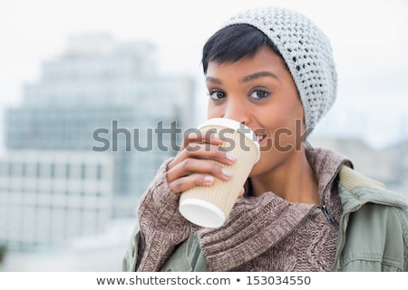 fashionable young woman sipping hot tea stock photo © juniart