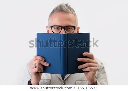 Man in glasses with blue book stock photo © boroda