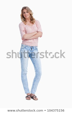 Thoughtful woman standing with arms folded Stock photo © deandrobot