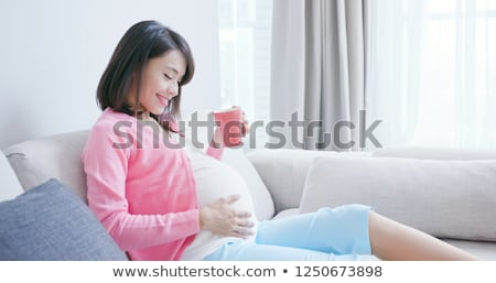 Stok fotoğraf: Mutlu · hamile · kadın · fincan · içme · çay · ev