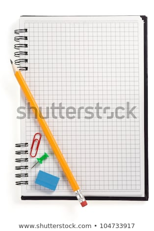 pencil on checked notebook isolated on white background stock photo © teerawit