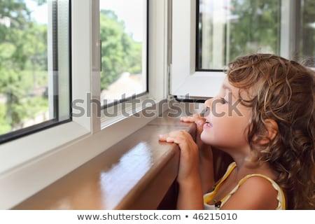 довольно улыбаясь девочку балкона посмотреть окна Сток-фото © Paha_L