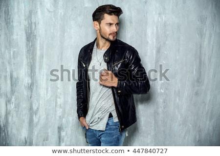 Retrato bonito sorridente moço preto jaqueta de couro Foto stock © deandrobot