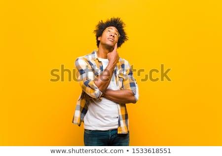 Koncentrált töprengő férfi felfelé néz gondolkodik pozitív Stock fotó © stevanovicigor