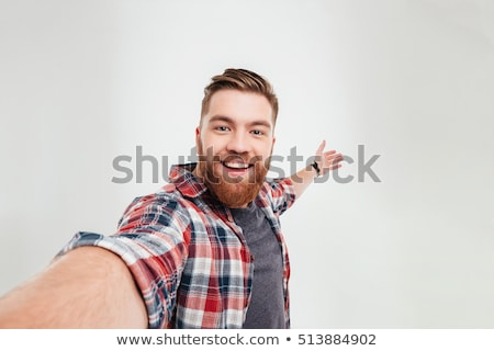 casual young man making selfie photo on smartphone stock photo © deandrobot